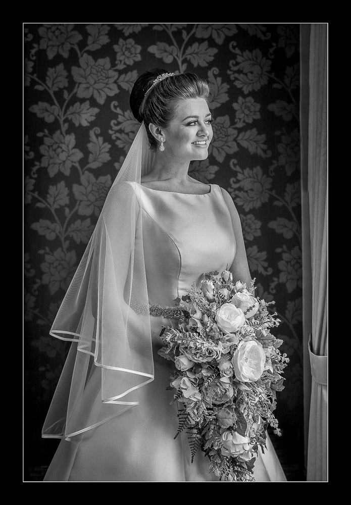 Bride looking out of the window in Barnsle